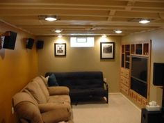 Paint The Basement Ceiling Another Nice Color Combination Like The Built In Tv Nook Bet Low Ceiling Basement Basement Lighting Basement Ceiling Ideas Cheap