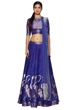Featuring a flaming indigo lehenga with exquisitely rich Banaras hand-woven work. Team this lehenga, choli and dupatta with gold earrings for an extravagantly gorgeous look. Rs.149,000.00
