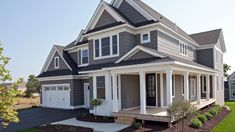 Grey Farmhouse Exterior Paint Color: The exterior of this home is painted Sherwin Williams Gauntlet Gray. The trim paint color is Sherwin Williams Pure White The front entry door is Sherwin Williams SW 6990 Caviar