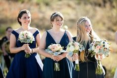 Lovely ladies watch their sister and best friend get married at an outdoor fall wedding.  #lyonswedding #lyonscolorado #mountainwedding #weddingstyle #bridesmaids #navyblue #outdoorwedding #coloradowedding
