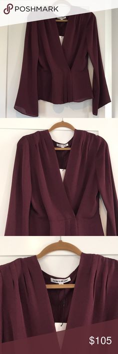 Elizabeth and James Blouse Elizabeth and James Layla blouse in a gorgeous plum color called Shiraz. Never worn. Tags still attached showing original price of $295. An amazing deal! (PJ43) Elizabeth and James Tops Blouses