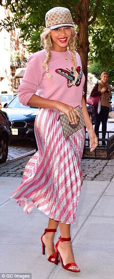 Wardrobe: Beyonce looked pretty in pink as she steps out in New York on Wednesday, while husband Jay Z's boasted about his drug dealing past