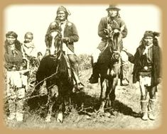 """Left to right, Perico - 2nd cousin of Geronimo - holding Nahbays baby, Chief Geronimo on horse, Chief Naiche on horse, and Fun, half-brother of Chief Perico. (""""Amazing photo of the powerful Geronimo"""" by C. S. Fly, Tombstone, Arizona, 1886)"""