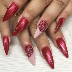 Red and pink cat-eye nails. The cat-eye nail designs are blowing up on social media. Click above to get 23 more examples of cat-eye nail art. #cateyenails #nails #naildesigns