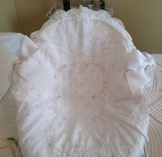 Seat slipcover made from vintage oval scalloped dresser scarf.