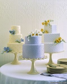 Whimsical and lighthearted, these pretty little cakes by Ron Ben-Israel Cakes are adorned with sprigs of sugar freesia in yellow, lavender, and white. The cakes are iced in the same colors, but paired with a differently hued flower.
