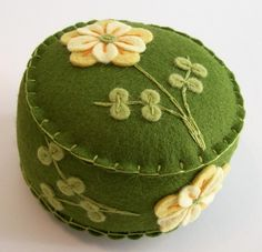 pin cushion, in a lovely deep green and yellow