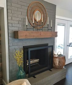 shanty2chic on Instagram.... Sometimes a good coat of paint and a shanty mantel are just what a home needs... Oh and all the cute stuff too... ❤️ paint is Gauntlet Grey by Sherwin-Williams and the screen was a Target find! ...#shanty2chic #diy #peaceloveshanty