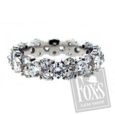 Diamond Eternity Band- WOW. love how the diamonds are not perfectly lined up