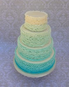 - All buttercream, Carribean Blue ombre ruffle wedding cake.  This is my FIRST wedding cake, and my first time to stack four tiers! I am so happy with how it turned out.