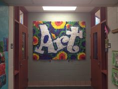 5th grade bottle top mosaic...in front of the art room doors