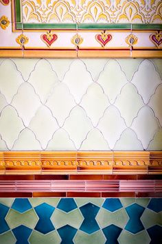 Brightly coloured tiles can make a bold statement any room of the house-hallways, living rooms, bathrooms or kitchens.
