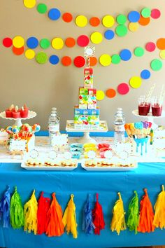 Colorful, vibrant, and fun, this Splatter Paint Party idea is loaded with inspiration to decorate a bright and fun kids' party environment.