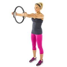 brooke griffin doing a standing arm press with a pilates ring
