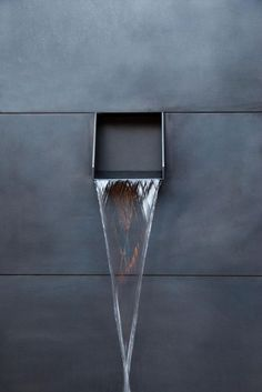 Fountains & Ponds | Contemporary metal spout from concrete facade