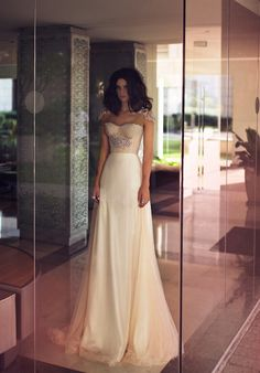 Modern, Glamourous, Sexy Wedding Dresses By Zahavit Tshuba | Bridal Musings... The model's face needs to be happier though. Her expression scares me right now. But BEAUTIFUL DRESS!