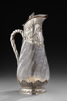 Lot : Aiguière en cristal à côtes torses... | Dans la vente Argenterie - Vente III  (Deauville) à Aguttes