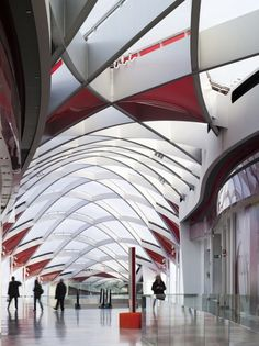 There certainly isn't a shortage of shapes and sizes in this shopping mall designed by Ron Arad Architects. Located near Santiago Calatrava's high speed ra