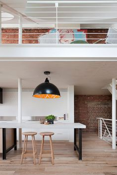 Over sized pendant light in the kitchen eating space. Clare Cousins Fitzroy