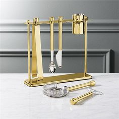 Shop top shelf bar tool set with stand.   Home bartenders, you're in luck.  Our gilded bar kit is ready to mix up some serious cocktails.