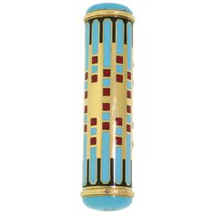 VAN CLEEF & ARPELS. An Art Deco Lipstick Case  France  Circa 1930's  Applied with a motif of geometric design, the gold case decorated with turquoise, black and red enamel, French assay marks for 18ct gold, signed and numbered, circa 1930.