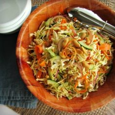 Spicy Peanut Cabbage Slaw - cabbage - red onion - small cucumber - carrot - salted peanuts - Dressing - lime - rice vinegar - creamy natural peanut butter - Sriracha - light agave - kosher salt