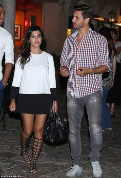 Monochrome Monday: Kourtney Kardashian captured attention in gladiator sandals and a black and white dress for dinner out with her better half Scott Disick and her mother Kris Jenner in Calabasas