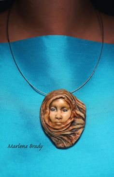 Marlene Brady: Polymer Pendant made from a mold.