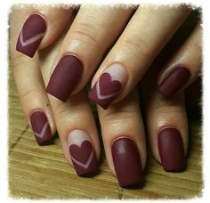 Deep matte red squared nails with hearts for details