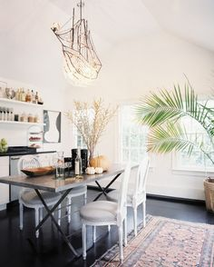 Who said you can't hang a chandelier in the kitchen? Even if your cooking space is relatively casual, nothing looks cooler than a grand, crystal fixture hovering over a laid back breakfast table.