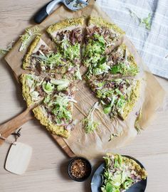 cauliflower + brussels sprout crust pizza with a white bean spread, caramelized onions + shredded sprouts