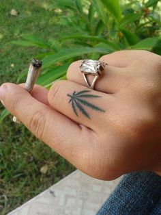 Cannabis leaf finger tattoo - subtle and pretty
