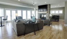 Gray furniture and light wood floors