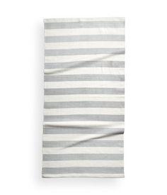 Light gray. Rectangular cotton rug with printed stripes. Non-slip backing.