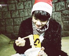 More eating Kookie! And oh look! He's wearing a Christmas hat and Christmas 2016 is right around the corner!  Posted this at the RIGHT TIME!  December 20, 2016  { #Eating #BTSEating #Jungkook #JeonJungkook #Kookie #GoldenMaknae #Maknae #BTS #BangtanBoys #BulletproofBoyscouts #BangtanSonyeondan #ARMY #AdorableRepresentativeMCForYouth #BigHitEntertainment #Kpop #Gif #BTSGif } ©KpopAmino