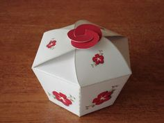 Free printable cupcake paper box template with cute floral accent