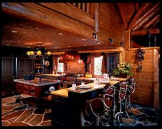 Log lodge kitchen. I love the chairs!!! They are awesome!