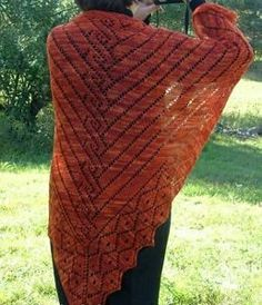 Channel the glory of ancient Greece with this beautifully intricate knit shawl pattern. The Greek Motif Shawl is a dazzling display of lace stitch work on a gorgeous field of burnt orange. This striking color is perfect for late autumn and winter.
