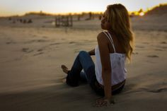I used spot metering on this image  due to the sun setting over her shoulder, making the sun and sand exceptionally bright behind her. By me...