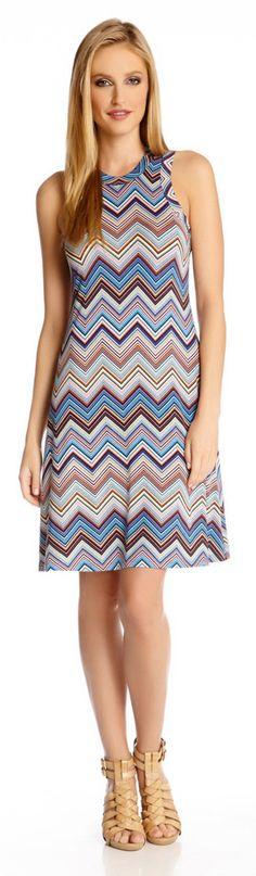 Vibrant zig-zag stripes wave bold color across this high-neck halter dress.