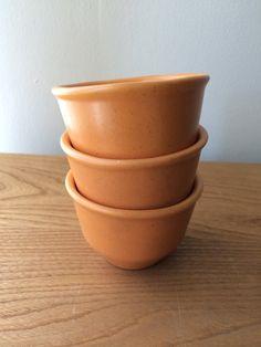 2 vintage pink and brownorange faceted bowls