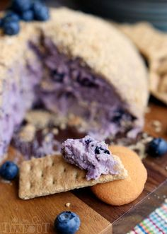 This Blueberry Pie Cheese Ball tastes just like a blueberry cheesecake and is the perfect appetizer or dessert for your next get together! Easy and delicious!   MomOnTimeout.com