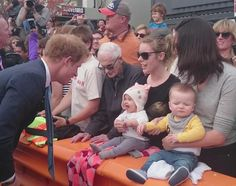 A beautiful smile for Prince Harry from a baby girl in #Christchurch today #RoyalVisitNZ
