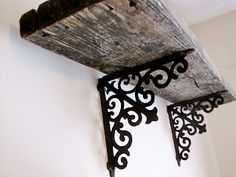 Weathered wood and rod iron. I want a shelf like this to go above the bed in my room. Wall mounted light fixtures to eliminate the need for bedside tables.