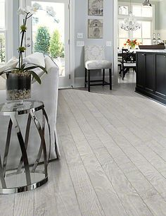 Recall the curative effects of the salt air and the play of light on a rippling ocean with our #coastal #hardwood #floors