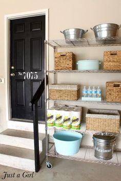Roundup: 6 Inspiring Impromptu Garage Mudrooms » Curbly | DIY Design Community Like the stenciled door! AND the storage space