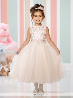 Sleeveless satin, lace and tulle tea-length full A-line dress with jewel neckline, metallic lace overlay bodice, gathered tulle circle skirt with wire edged