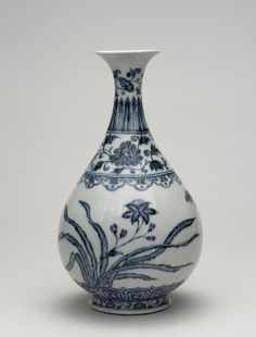 Porcelain bottle vase of yuhuchun form, with a pear-shaped body, narrow neck and flaring mouth rim.  Decorated in underglaze blue. Band of lingzhi fungi below the mouth rim, plantain leaves and lotus flowers on the neck, and lily plants with a butterfly on the body.  Glazed base.