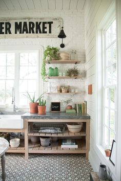 Never before seen space of Joanna Gaines! Farmhouse laundry room. Love the painted brick sign!