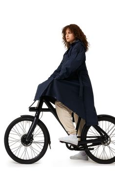 The Trench Coat is a fully waterproof raincoat, made from organic cotton and 111 recycled plastic bottles. The oversized, classic silhouette with a modern twist is designed for movement. The unisex coat easily transforms into a poncho for your bike or scooter by use of the MAIUM signature zippers and has a long fit. Go for this elegant coat to look stylish while being protected from bad weather! Shop Jackets, Recycle Plastic Bottles, Zippers, Trench, Baby Strollers, Organic Cotton, That Look, Raincoat, Navy Blue